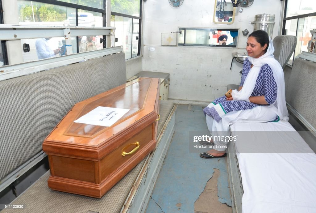 Gurpinder Kaur weeping bitterly to se the coffins of her brother Manjinder Singh which was brought from Iraq at Sri Guru Ram Dass Jee International...