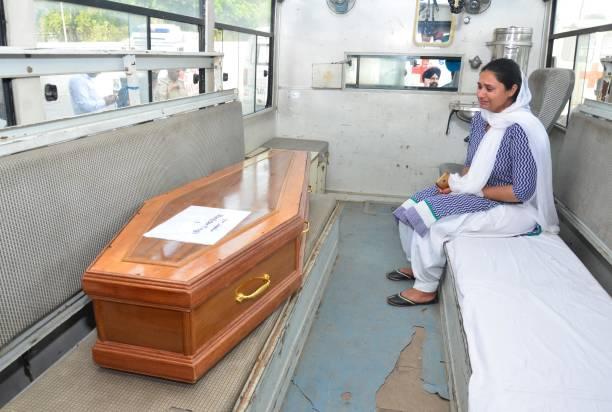 Gurpinder Kaur weeping bitterly to se the coffins of her brother Manjinder Singh which was brought from Iraq at Sri Guru Ram Dass Jee International...
