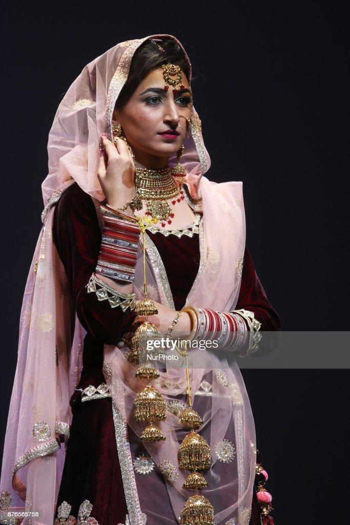 Gurpreet Kaur winner of the titles Miss World Punjaban and Miss Haryana Punjaban competes during the traditional bridal attire segment of the Miss...