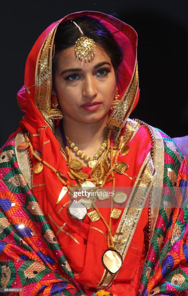 Gurpreet Kaur winner of the titles Miss World Punjaban and Miss Haryana Punjaban competes during the traditional Giddha dance segment of the Miss...