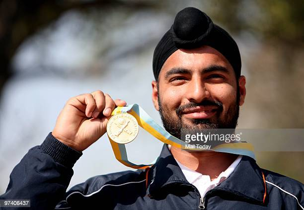 Gurpreet Singh after winning the gold in the 25 m standard pistol event at the Commonwealth Shooting Championship in New Delhi on February 27 2010