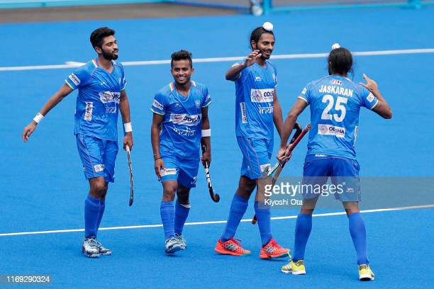 Gursahibjit Singh of India celebrates with his teammates after scoring his side's fourth goal in the Men's Final match between New Zealand and India...