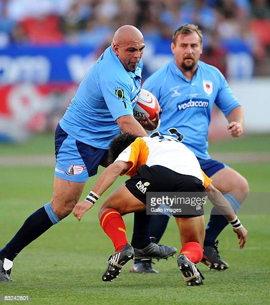 Gurthro Steenkamp is tackled by Robert Ebersohn during the Absa Currie Cup semi final match between Blue Bulls and Cheetahs held at Loftus Versfeld...