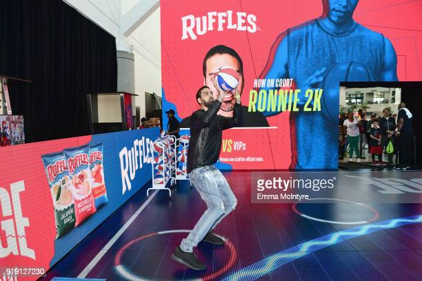 "NBA2K guru ""Ronnie 2K"" challenges fans to a hoops competition at Ruffles' ""The RIDGE"" 4 pointline footprint in Los Angeles during NBA AllStar..."
