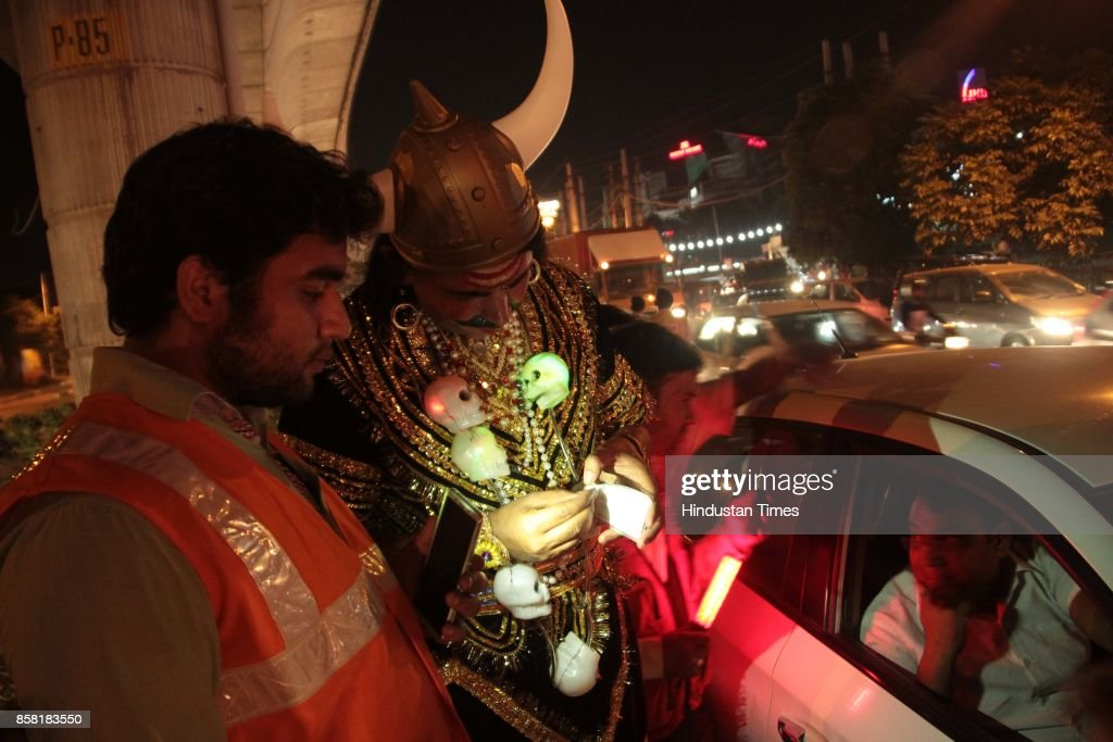 Gurugram Police in action during the special drive for the drink and driving offenders where a cop, dressed as Yamraj, a god of Death, to spread awareness, challans the offenders, on September 29, 2017 in Gurugram, India.