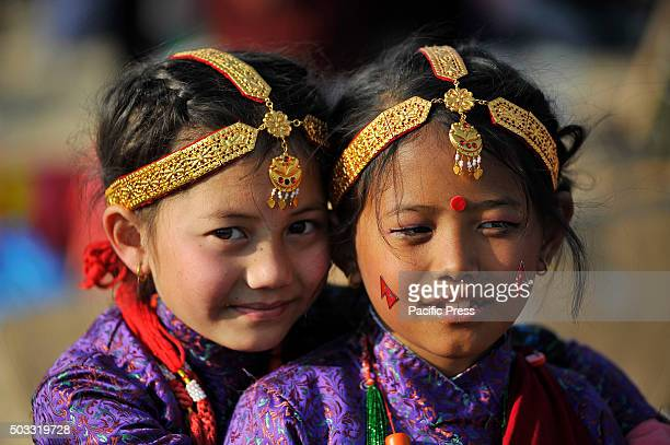 KATHMANDU NEPAL KATHMANDU NP NEPAL Gurung community kids smiles and plays with each other in a traditional attire during the celebration of Tamu...
