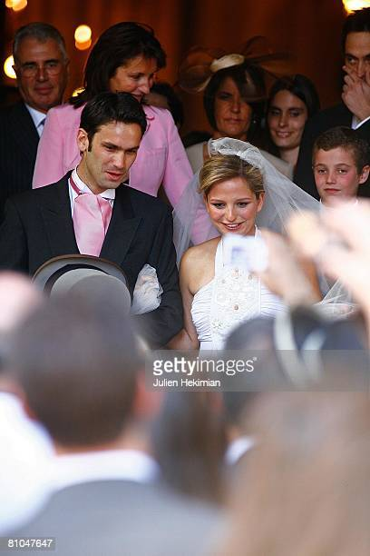 Gurvan Rallon JeanneMarie Martin and her mother Cecilia Attias leave St Pierre de Neuilly church on May 10 2008 in Paris France