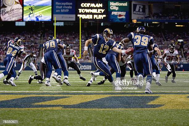 Gus Frerotte of the St Louis Rams hands off the ball to Steven Jackson during the NFL game against the Atlanta Falcons at Edward Jones Dome on...