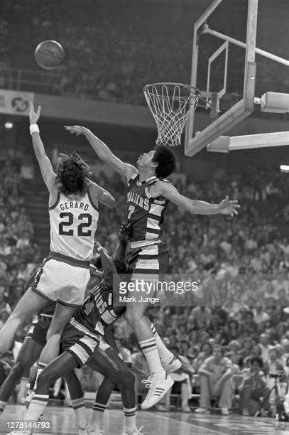 Gus Gerard of the Denver Nuggets shoots over Bingo Smith during a game against the Cleveland Cavaliers at McNichols Arena on December 9 1976 in...