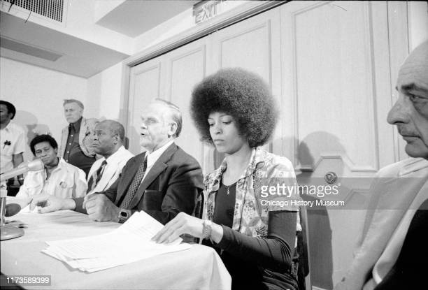 Gus Hall , General Secretary of the United States Communist Party, third from right, and American political activist and educator Angela Davis,...