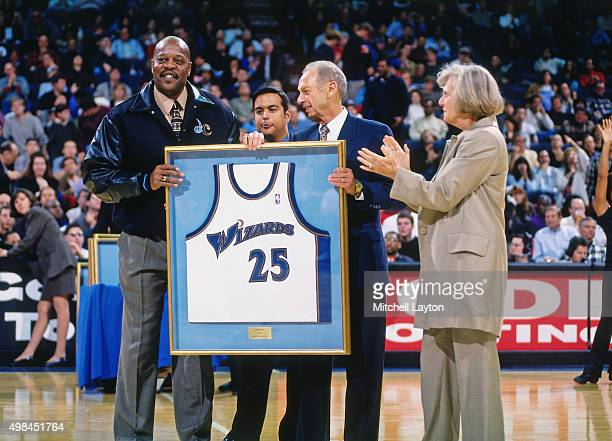 Gus Johnson of the Washington Wizards is presented a jersey against the Chicago Bulls on November 29 1997 at US Airways Arena in Landover Maryland...