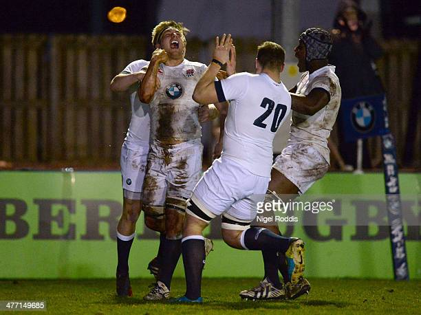 Gus Jones of England celebrates with teamates after scoring his fourth try during the Six Nations International match between England U20 and Wales...