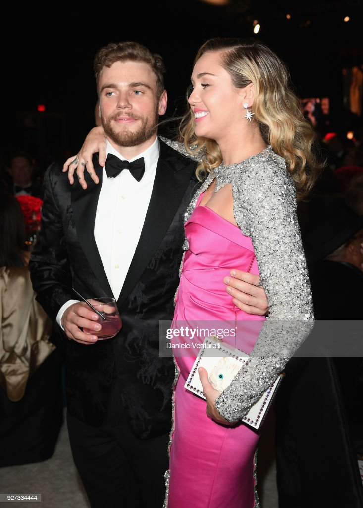 Gus Kenworthy (L) and Miley Cyrus attend Elton John AIDS Foundation 26th Annual Academy Awards Viewing Party at The City of West Hollywood Park on March 4, 2018 in Los Angeles, California.