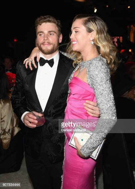 Gus Kenworthy and Miley Cyrus attend Elton John AIDS Foundation 26th Annual Academy Awards Viewing Party at The City of West Hollywood Park on March...