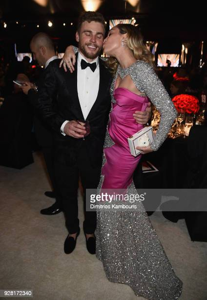 Gus Kenworthy and Miley Cyrus attend the 26th annual Elton John AIDS Foundation Academy Awards Viewing Party sponsored by Bulgari, celebrating EJAF...