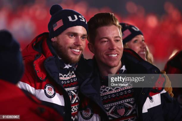 Gus Kenworthy and Shaun White of the United States enter the stadium during the Opening Ceremony of the PyeongChang 2018 Winter Olympic Games at...