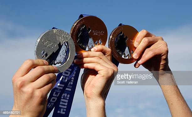 Gus Kenworthy Joss Christensen and Nick Goepper of the USA Skiing team display their medals in the Olympic Park during the Sochi 2014 Winter Olympics...