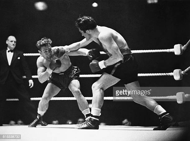 Gus Lesnevich Cliffside NJ world's light heavyweight champion takes a hard right from Freddie Mills of England during their scheduled 15round bout at...