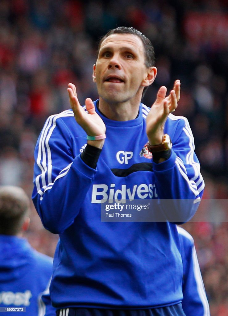 Gus Poyet manager of Sunderland joins his players in a lap of honour after the Barclays Premier League match between Sunderland and Swansea City at Stadium of Light on May 11, 2014 in Sunderland, England.