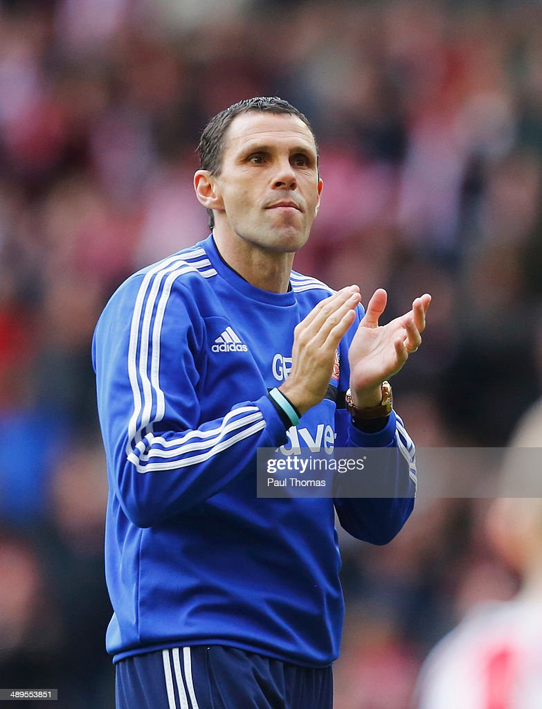 Gus Poyet manager of Sunderland joins his players on a lap of honour after the Barclays Premier League match between Sunderland and Swansea City at Stadium of Light on May 11, 2014 in Sunderland, England.