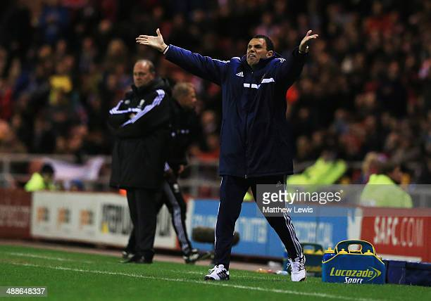 Gus Poyet manager of Sunderland reacts as Pepe Mel manager of West Bromwich Albion looks on during the Barclays Premier League match between...