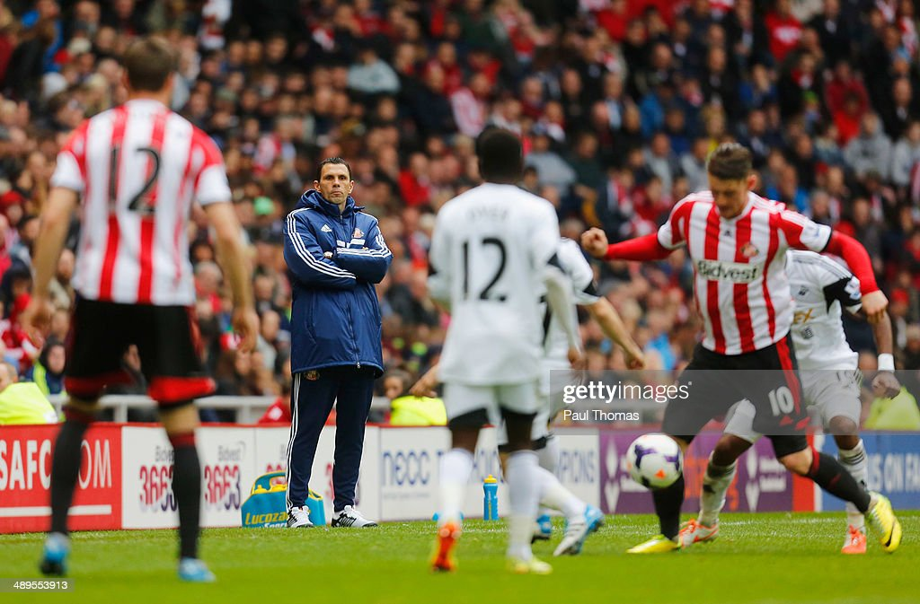 Gus Poyet manager of Sunderland watches the action during the Barclays Premier League match between Sunderland and Swansea City at Stadium of Light on May 11, 2014 in Sunderland, England.