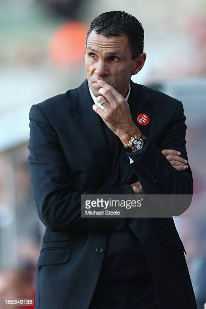 Gus Poyet the manager of Sunderland looks on from the dugout during the Barclays Premier League match between Swansea City and Sunderland at the...