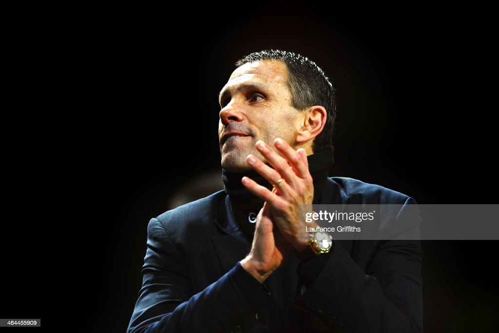 Gus Poyet the Sunderland manager celebrates after his team won 2-1 in the penalty shootout during the Capital One Cup semi final, second leg match between Manchester United and Sunderland at Old Trafford on January 22, 2014 in Manchester, England.