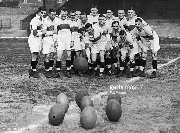 Gus Risman captain of the Salford rugby team uses a football and seven rugby balls to play skittles during a training session at Salford 3rd May 1938...
