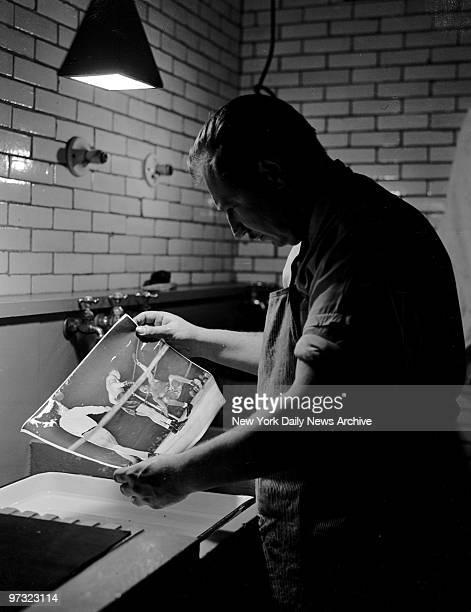 Gus Schoenbaechler in the Daily News darkroom