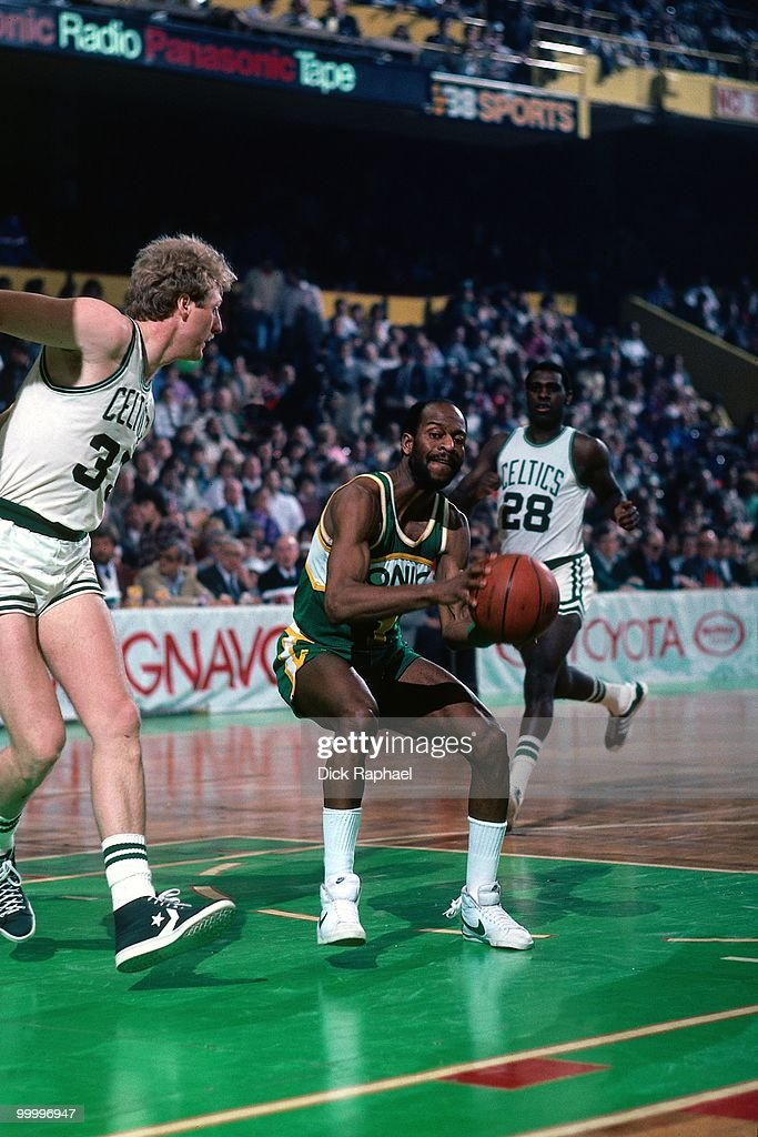 Gus Williams #1 of the Seattle Supersonics looks to make a move against Larry Bird #33 of the Boston Celtics during a game played in 1983 at the Boston Garden in Boston, Massachusetts.