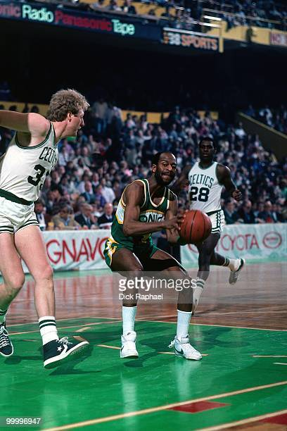 Gus Williams of the Seattle Supersonics looks to make a move against Larry Bird of the Boston Celtics during a game played in 1983 at the Boston...