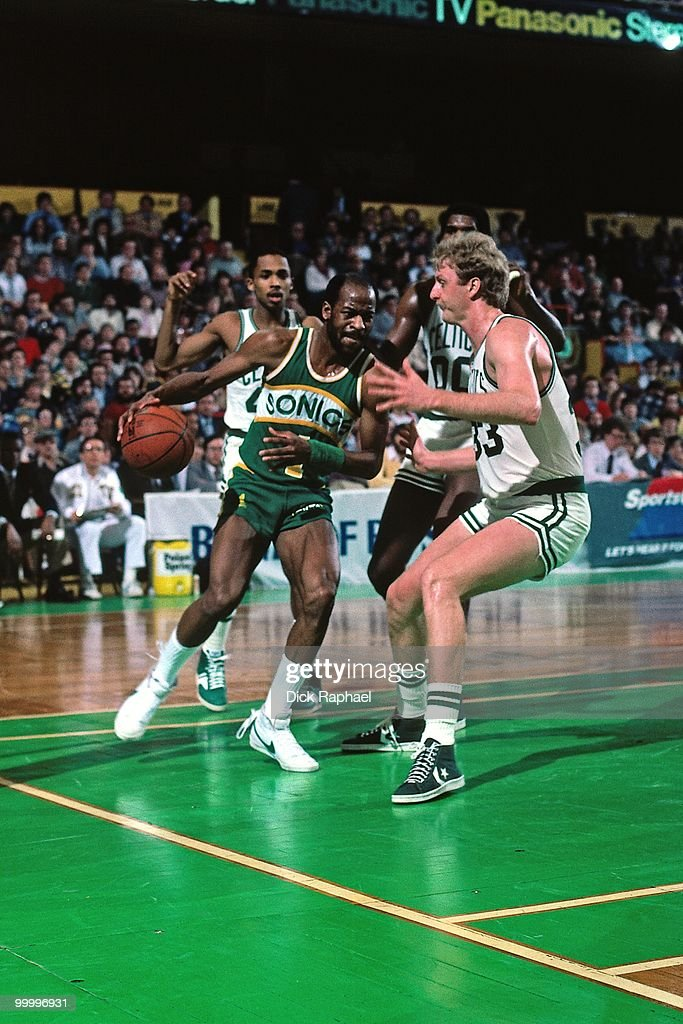 Gus Williams #1 of the Seattle Supersonics makes a move to the basket against Larry Bird #33 of the Boston Celtics during a game played in 1983 at the Boston Garden in Boston, Massachusetts.