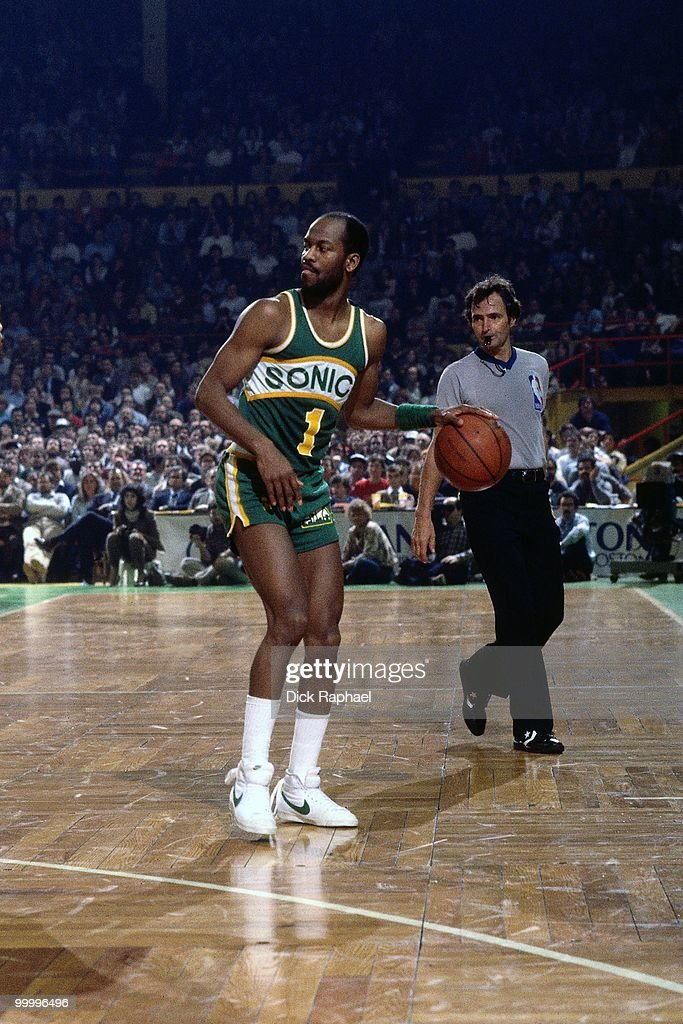 Gus Williams #1 of the Seattle Supersonics moves the ball up court against the Boston Celtics during a game played in 1983 at the Boston Garden in Boston, Massachusetts.