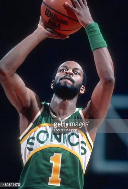 Gus Williams of the Seattle Supersonics shoots a free throw against the Washington Bullets during an NBA basketball game circa 1983 at the Capital...