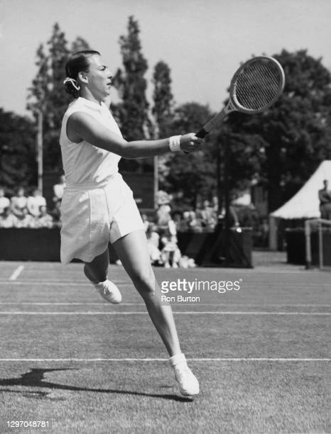Gussie Moran of the United States makes a forehand return to Sheila Dowdeswell of during their Women's Singles First Round match at the Kent Lawn...
