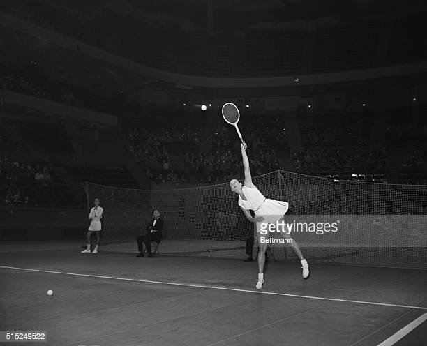 Gussie Moran Tennis player is shown returning the ball in a match with Pauline Betz at Madison Square Garden