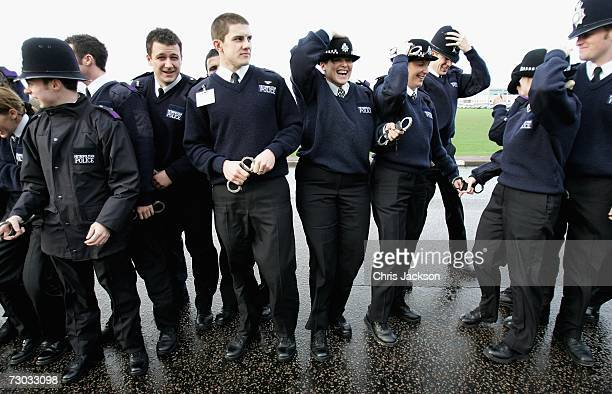 A gust of wind blows as Metropolitan Police recruits prepare to take part in a the world record for the most amount of people handcuffed in one go at...