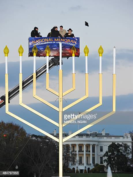 A gust of wind blows off the hat of Rabbi Levi Shemtov Washington Director American Friends of Lubavitch as White House Budget Director Jacob Lew and...