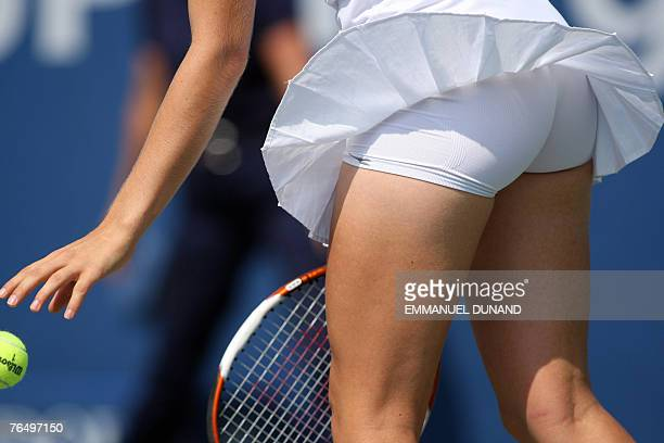 A gust of wind liftup Hungarian tennis player Agnes Szavay's skirt as she gets ready to serve against Ukrainian player Julia Vakulenko in their...