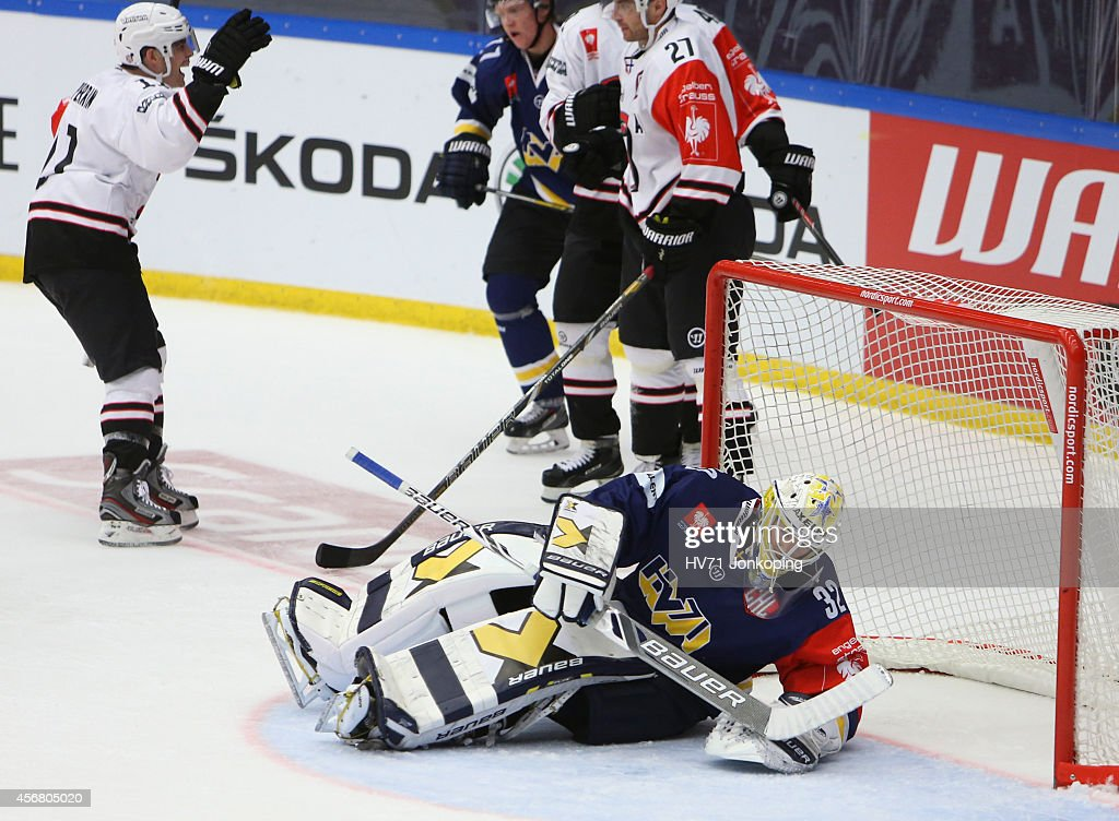 Gustaf Wesslau #32 Goaltender of HV71 fails to stop a puck and Tuomas Pihlman #49 of JYP Jyvaskyla makes it 2-0 during the Champions Hockey League group stage game between HV71 Jonkoping and JYP Jyvaskyla on October 7, 2014 in Jonkoping, Sweden.