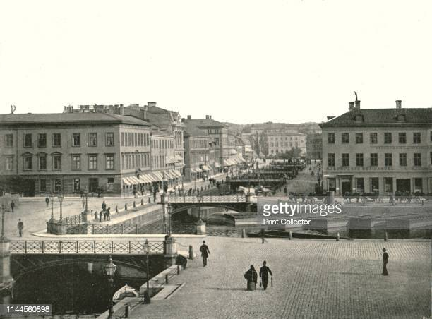 """Gustav Adolfs torg and Ostra Hamngatan, Gothenburg, Sweden, 1895. From """"Round the World in Pictures and Photographs: From London Bridge to Charing..."""