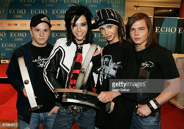 Gustav Bill Tom and Georg members of the band Tokio Hotel hold their awards for Newcomer International at the Echo 2006 Music Awards on March 12 2006...
