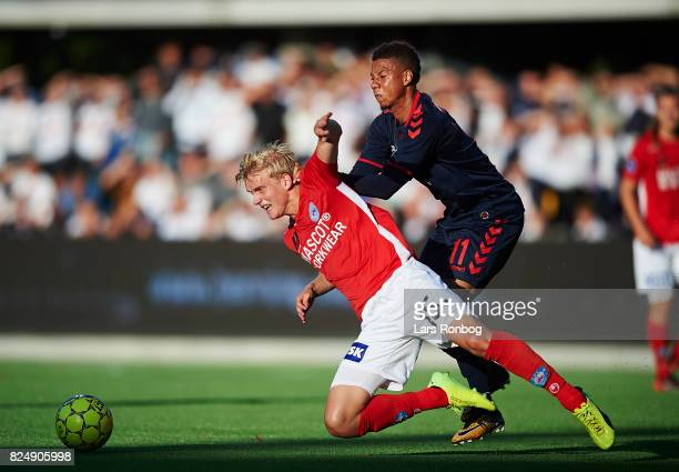 Gustav Dahl of Silkeborg IF and Tobias Sana of AGF Aarhus compete for the ball during the Danish Alka Superliga match between Silkeborg IF and AGF...