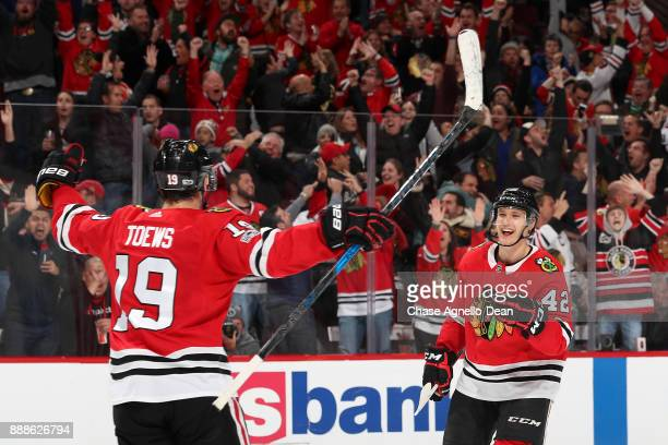 Gustav Forsling and Jonathan Toews of the Chicago Blackhawks celebrate after Forsling scored the gamewinning goal in overtime against the Buffalo...