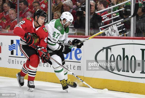 Gustav Forsling of the Chicago Blackhawks and Alexander Radulov of the Dallas Stars chase the puck in the second period at the United Center on...