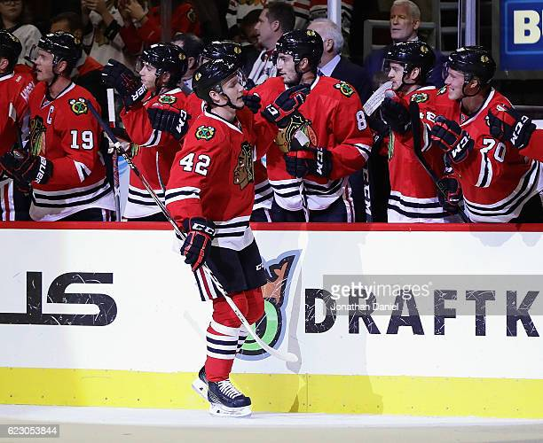Gustav Forsling of the Chicago Blackhawks is congratulated by teammates after scoring his first NHL goal in the first period against the Montreal...