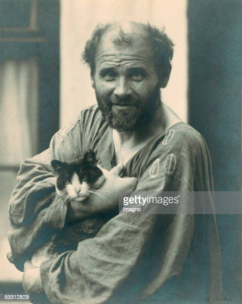 Gustav Klimt holding one of his cats in his arms in front of his studio in Vienna 8th district Josefstaedter Strasse Photography by Moriz Naehr...