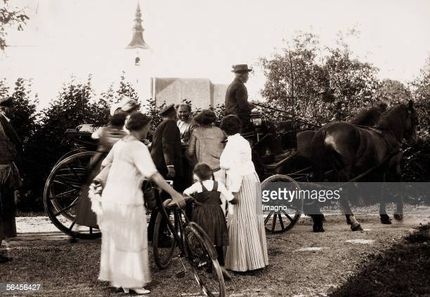 Gustav Klimt says goodbye to his guests in front of a horsedrawn carriage in the background the church of Seewalchen Photography 1913 [Gustav Klimt...