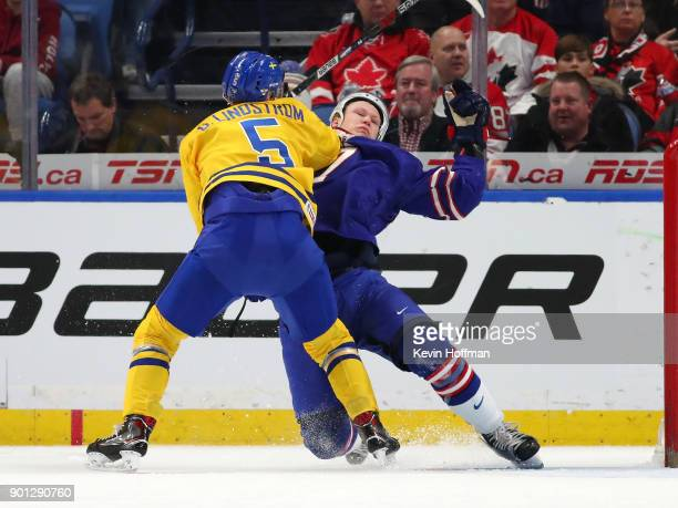 Gustav Lindstrm of Sweden gets a penalty for hooking Brady Tkachuk of United States in the first period during the IIHF World Junior Championship at...